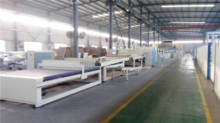 Corrugated board delivery and stacker